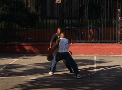 Two Men Play Basketball In Poor Neighborhood