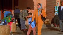 Mother & Son Walk Down Street, Morocco
