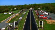 Aerial Over Race Track As A Car Drives Along