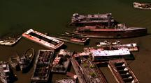 Shipyard Filled With Rusty Old Ships And Boats - Aerial Around Coastline
