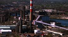 Refinery With Smoke Stack - Commercial And Residential Neighborhood In Background