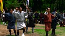 Men Practicing A Traditional Archery Dance