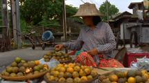 Woman Sells Fruit At Outdoor Marketplace
