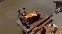 People Preparing Body For Cremation