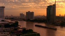 Barge Crosses In Front Of Bangkok Skyline, From Across River