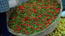 Tilt To From Red And Green Peppers To Vendor At The Marketplace