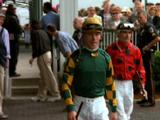 Jockeys Walk Through Specators At Kentucky Derby
