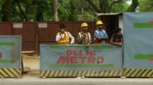 Traffic Passes Men Working Construction Site