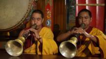 Buddhist Monks Play Instruments During Prayer