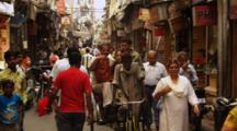 Pedestrians Walk In Crowded Market, People On Pedicab