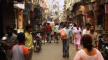Pedestrians Walk In Crowded Market, People In Pedicab