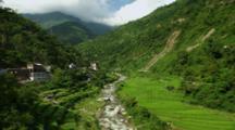River Through Village And Farmland