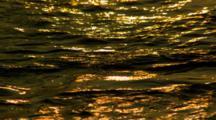 Golden Sunset Light Reflects Off Surface Of Ocean