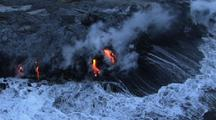 Aerial Of Lava Flowing Into Sea, Creating Steam