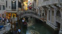 Small Bridge Over Canal With Gondolas