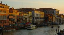 Motorboats And Gondolas On The Grand Canal At Sunset