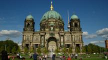 People Walk In Front Of Berlin Cathedral