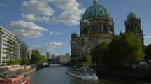 Boats Pass Berlin Cathedral And The Spree River