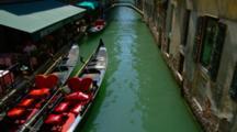Restaurant, Gondolas, And A Bridge On A Venice Canal