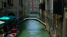 Bridge, Gondolas, And Boats On Venice Canal