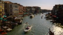 Boats Travel Down Canal In Venice