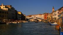 Gondolas And Motorboats In Front Of The Rialto Bridge