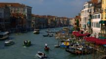 Motorboats And Gondolas Travel Up And Down Venice Canal