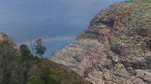 Aerial View Of Cliffs, Rainbow Above Hawaii Coastline