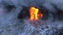 Aerial Of Molten Lava Flowing Into Ocean, Steam