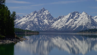Snow Capped Teton Mountains Reflected In Lake