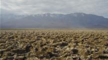 Salt Flats In Death Valley With Mountains Behind