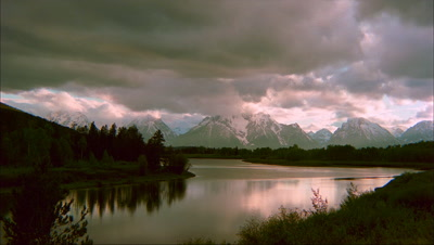 Sunset And Clouds Reflected In Grand Teton National Park