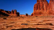 Courthouse Towers Reflect In Water, Arches National Park
