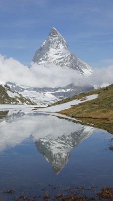 Vertical Time Lapse Matterhorn Reflected In Lake, Switzerland