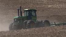Tractor Drives In Wheat Field In Palouse Washington