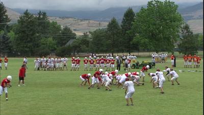 Team Playing Southern Oregon University Football Stadium