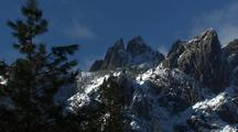 Jagged Mountain Peaks With Snow