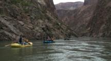 Several River Rafts Float Down River