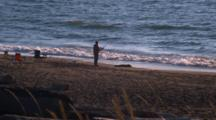 Man Surf Fishing From Shore