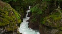 Fast Moving Creek, Rapids In Narrow Gorge