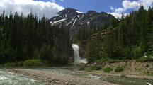 Distant View Of Eagle Falls With Creek And Mountain