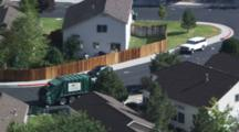 Man Dumping Trash Into A Garbage Truck At A Housing Development Neighborhood Near Rattlesnake Mountain In Reno, NV.