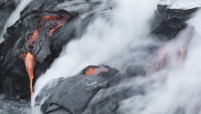 Kīlauea Volcano in Iceland; lava flow pouring into ocean