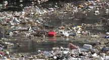 Trash Collects In Los Angeles River System, Contained By Boom