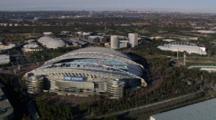 Aerial Travel Past Sydneys Olympic Park, Anz Stadium Looking Towards Sydney Cbd In The Background