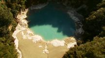Aerial Of Volcanic Area, River And Blue Lake