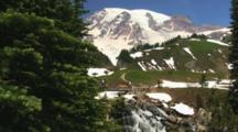 Tourists Hiking Along The Alpine Meadows Of Mount Rainier National Park, Washington