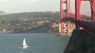 Boat Sails Toward Golden Gate Bridge