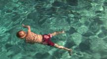 Two Boys (5 Yrs Old) Swimming Underwater In A Pool, Camarillo, California