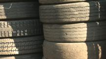 Used Car Tires Stacked High, Zoom In